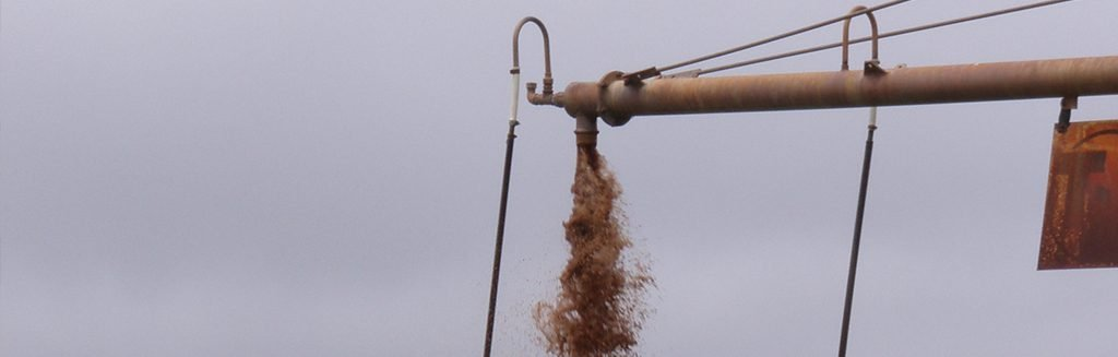 water with iron bacteria flowing out of an agricultural bore